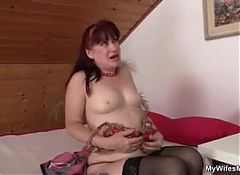 Pretty mother-in-law takes cock from behind