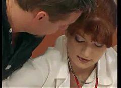 Redhead mature nurse