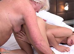 GILF licks ass and pussy of young lesbian girl