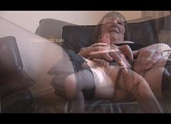 Hairy granny in stockings posing and spreading