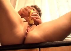 Horny granny solo in the kitchen