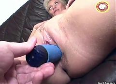 Mature gets her pussy dildoed and sucks cock