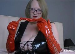 Black PVC dress and red whip