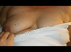 Granny amateur playing tits and clit