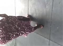 Slim booty African GILF in tight long dress