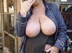 Big tits wife rubs it outside