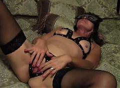 Mature wife in a mask masterbates