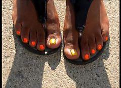 Charley Orange Toenails