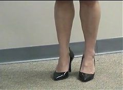 Shoeplay in class black heels and skirt