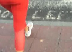Fine ass on a girl in tight bright red leggings p1